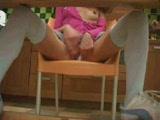 Girl masturbating under the table