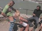 Cute blonde gets fucked by two guys in public