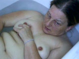 Mature woman in the tub