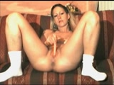 Sexy babe dildo fucks herself on the couch