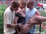 Slut fucked by two strangers in public park