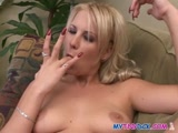 Blonde fingers her pussy