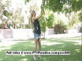 Leslie Mesmerising Blonde Girl Walking Near A Tree