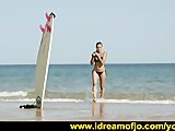 Hot babe enjoys the surf