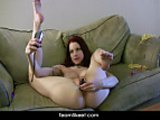 Tattooed redhead Kajira striptease solo dildo