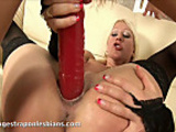 Elenor pounding her friend Dionne with a huge strapon dildo