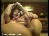 Asian MILF double penetrates herself with ...