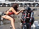 Chick tries to do a sexy bike wash, but fails miserably