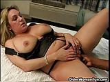 Buxom milf creamed between her big tits