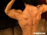 Female Bodybuilder Plays With Her Big Clit On Her Couch