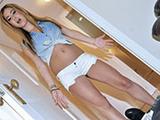 Sassy wears a schoolgirl outift